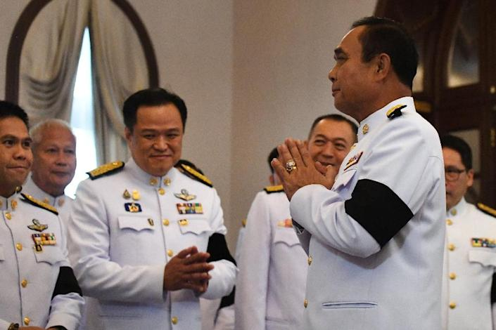 Junta leader and new prime minister Prayut Chan-O-Cha (front R) promised to 'listen to the voices of the people' and protect the monarchy (AFP Photo/Lillian SUWANRUMPHA)