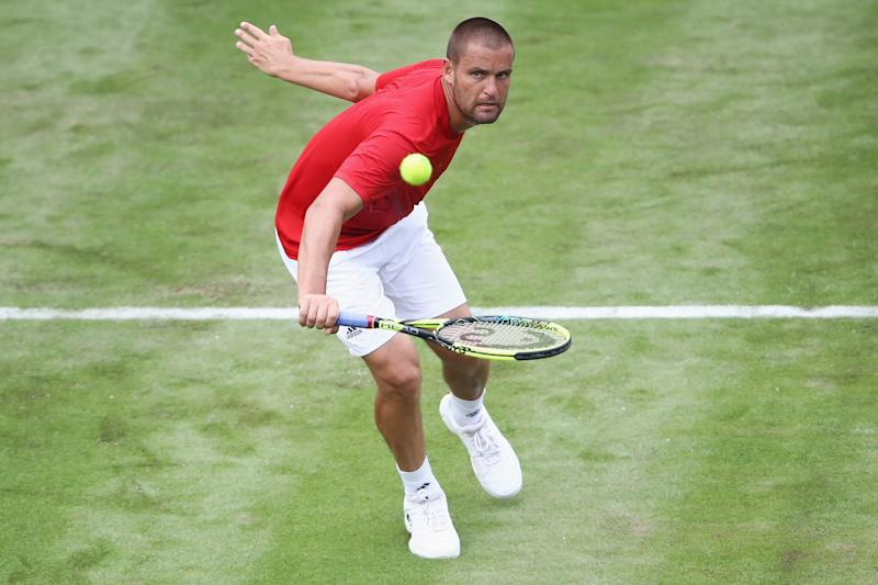 Mikhail Youzhny of Russia takes a volley.