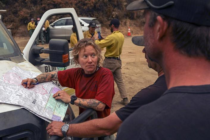 "Bureau of Land Management firefighters plan an attack on the Bobcat fire. <span class=""copyright"">(Irfan Khan / Los Angeles Times)</span>"