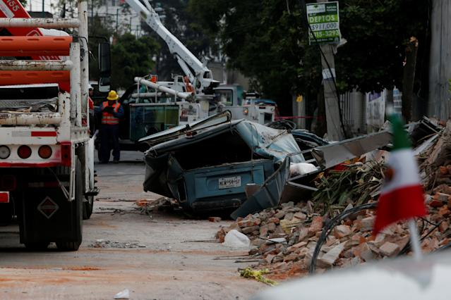 <p>A damaged wall and a smashed vehicle are pictured after an earthquake in Mexico City, Mexico Sept. 8, 2017. (Photo: Carlos Jasso/Reuters) </p>