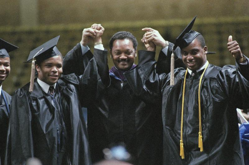 FILE - In this May 8, 1988 file photo taken in Greensboro, N.C., Jesse Jackson poses with his sons Jesse Jr., left, and Jonathan, right, at the Greensboro Coliseum, after he gave the commencement address and his sons graduated from North Carolina A&T. At 71, Jackson Sr. still keeps a hectic schedule and speaks extemporaneously on civil rights issues of all kinds. But he struggles when addressing one thing: Jesse Jackson Jr., the son and heir to Jackson's political influence who abandoned his congressional seat last week because of mental health problems and two federal investigations.  (AP Photo/Bob Jordan, File)