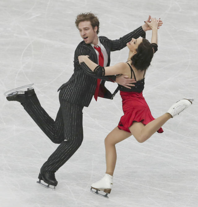 Nathalie Pechalat and Fabian Bourzat of France perform during Ice Dance Short Dance of the World Figure Skating Championships in Saitama, near Tokyo, Friday, March 28, 2014. (AP Photo/Koji Sasahara)