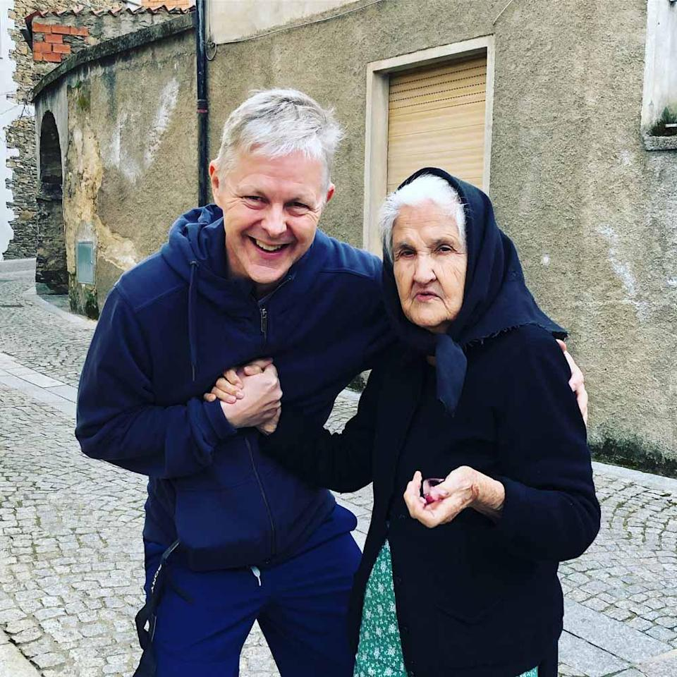 Chris with the widow Maria in Sardinia, where there are no old age homes. PA REAL LIFE