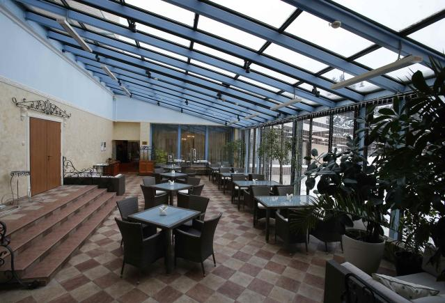"An interior view shows the restaurant ""Winter garden"" at the Moscow Country Club hotel and golf resort which was chosen to be the base for the Belgian national soccer team during the 2018 FIFA World Cup in the village of Nakhabino, outside Moscow, Russia February 10, 2018. REUTERS/Tatyana Makeyeva"