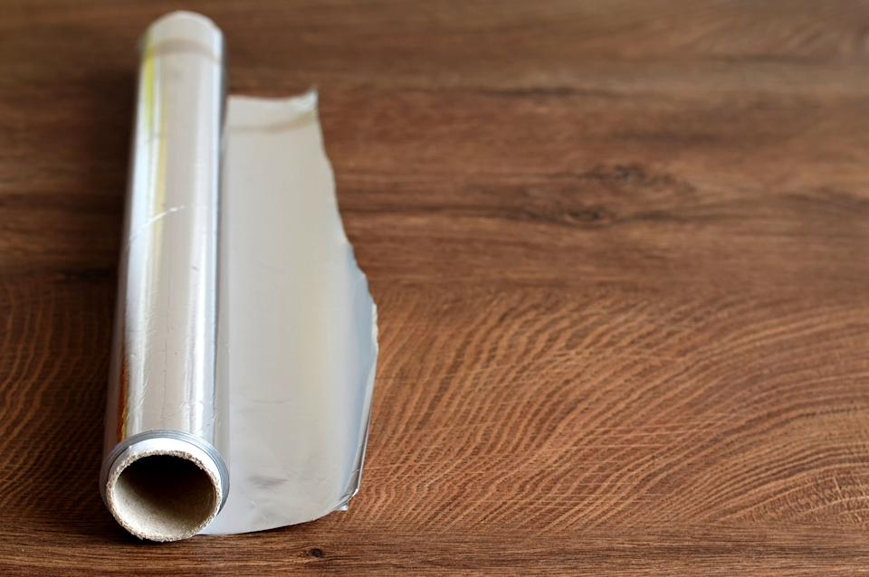 A TikTok user has shared a clever kitchen foil hack to ensure it breaks off in a perfect line every time. (Getty Images)