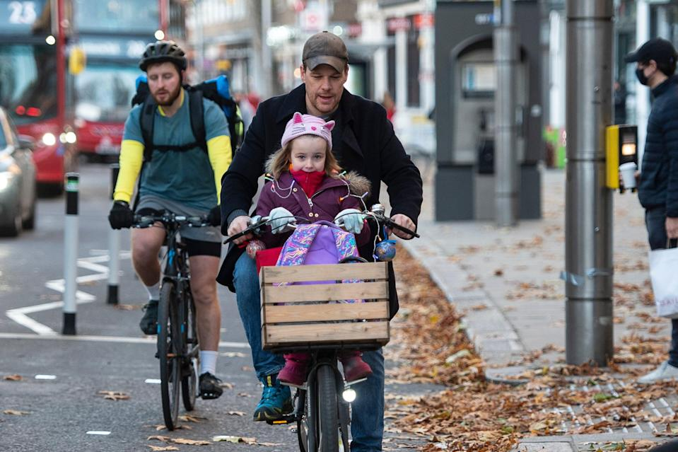 <p>About 100 cyclists covered in tinsel rode along Kensington High Street this morning</p> (Daniel Hambury/Stella Pictures Ltd)