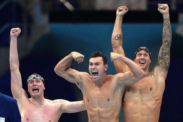 PHOTO: United States men's 4x100m freestyle relay team Bowen Beck, Blake Pieroni, and Caeleb Dressel celebrate after winning the gold medal at the 2020 Summer Olympics, Monday, July 26, 2021, in Tokyo, Japan. (Matthias Schrader/AP Photo)