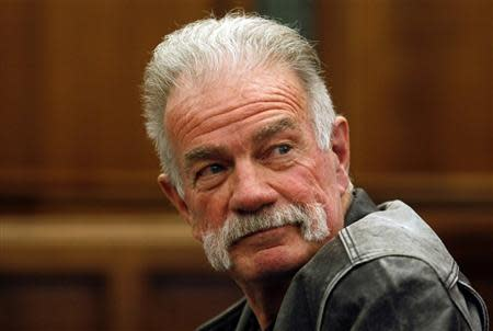 Controversial Florida pastor Terry Jones sits in the courtroom of the 19th District Dearborn Court for a hearing in front of Judge Mark Somers about Jones' right to protest in Dearborn, Michigan in this April 21, 2011 file photo. REUTERS/Rebecca Cook/files