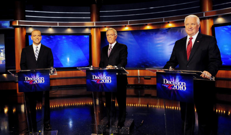 Democrat candidate Dan Onorato, left, moderator John Baer, center, and Republican nominee Tom Corbett, right, take part in a gubernatorial debate in Pittsburgh, Saturday, Oct. 16, 2010. (AP Photo/John Heller)