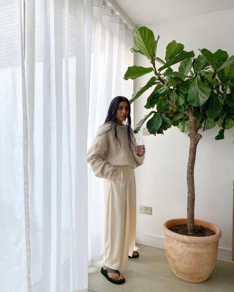 """<p>Size up in wide-leg suit trousers, preferably palazzo, and in a natural fabric.</p><p><a class=""""link rapid-noclick-resp"""" href=""""https://go.redirectingat.com?id=127X1599956&url=https%3A%2F%2Fwww.cosstores.com%2Fen_gbp%2Fwomen%2Fwomenswear%2Ftrousers%2Fproduct.high-waisted-wide-cotton-trousers-black.0930903001.html&sref=https%3A%2F%2Fwww.elle.com%2Fuk%2Ffashion%2Fg29844296%2Fcasual-clothes%2F"""" rel=""""nofollow noopener"""" target=""""_blank"""" data-ylk=""""slk:SHOP NOW"""">SHOP NOW</a></p><p><a href=""""https://www.instagram.com/p/CJLpJ6ZhLSr/"""" rel=""""nofollow noopener"""" target=""""_blank"""" data-ylk=""""slk:See the original post on Instagram"""" class=""""link rapid-noclick-resp"""">See the original post on Instagram</a></p>"""