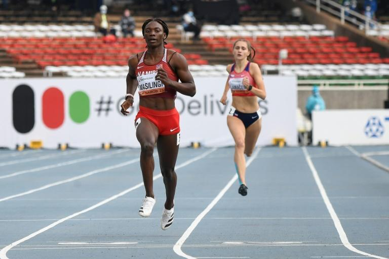 Namibia's Beatrice Masilingi (L) set a new championship record of 22.19sec in qualifying for the 200m final at the U20 World Athletics Championships in Nairobi