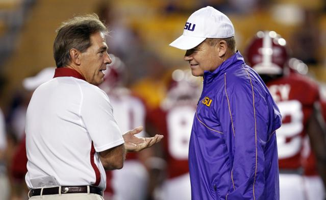FILE - In this Nov. 3, 2012, file photo, Alabama head coach Nick Saban, left, and LSU head coach Les Miles greet each other before their NCAA college football game in Baton Rouge, La. The two teams play on Saturday in Tuscaloosa, Ala. (AP Photo/Gerald Herbert, File)