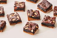 """These decadent, two-layer flourless brownies are easily customizable. You can use either almond butter or peanut butter in the bottom layer, and if you want to make them dairy-free, you can use coconut oil in place of butter. Top with chocolate chips, chopped pretzels, or any other crunchy snacks you have in the pantry. <a href=""""https://www.epicurious.com/recipes/food/views/double-decker-peanut-butter-brownies?mbid=synd_yahoo_rss"""" rel=""""nofollow noopener"""" target=""""_blank"""" data-ylk=""""slk:See recipe."""" class=""""link rapid-noclick-resp"""">See recipe.</a>"""