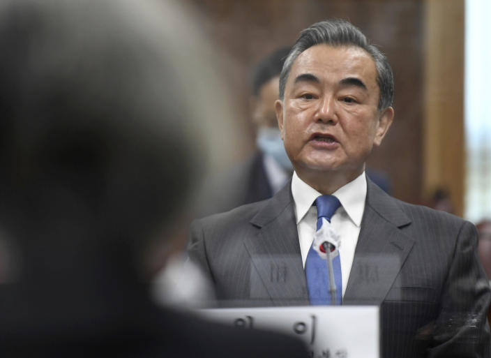 Chinese Foreign Minister Wang Yi talks with South Korean Foreign Minister Kang Kyung-wha during their meeting at the foreign ministry in Seoul, South Korea, Thursday, Nov. 26, 2020. Wang arrived in Seoul on Nov. 25, for a three-day state visit.(Kim Min-hee/Pool Photo via AP)