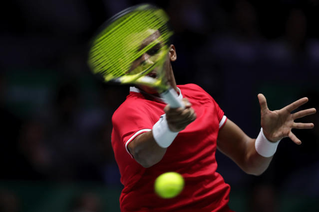 Canada's Felix Auger-Aliassime hits a forehand to Spain's Roberto Bautista Agut during their tennis singles match of the Davis Cup final in Madrid, Spain, Sunday, Nov. 24, 2019. (AP Photo/Manu Fernandez)