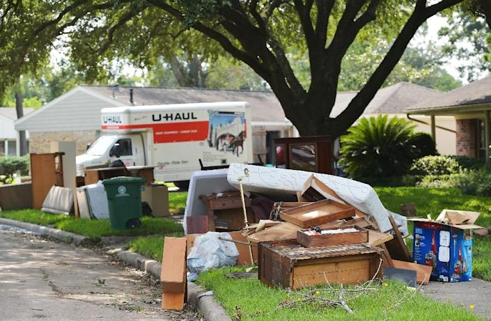 Piles of flood damaged furniture and personal belongings are thrown out in front of homes in Houston's Westbury neighborhood (AFP Photo/MANDEL NGAN)