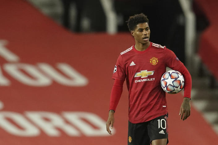 Manchester United's Marcus Rashford walks end of the Champions League group H soccer match between Manchester United and RB Leipzig, at the Old Trafford stadium in Manchester, England, Wednesday, Oct. 28, 2020. (AP Photo/Dave Thompson)