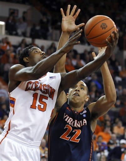Clemson's Devin Coleman (15) goes for a layup against Virginia's Malcolm Brogdon (22) during the first half of an NCAA college basketball game Tuesday, Feb. 14, 2012, in Clemson, S.C. (AP Photo/Rainier Ehrhardt)