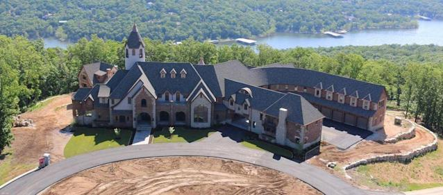 Cole and Heidi Hamels have donated their 32,000 square foot mansion in Table Rock Lake, Missouri to charity. (Realtor.com)