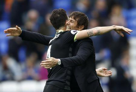 Britain Football Soccer - Everton v Chelsea - Premier League - Goodison Park - 30/4/17 Chelsea manager Antonio Conte celebrates after the match with Cesc Fabregas Action Images via Reuters / Carl Recine Livepic