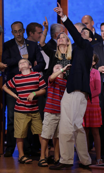 Republican vice presidential nominee, Rep. Paul Ryan of Wisconsin points out the balloons with his wife Janna to their children, (L-R), Charlie, Sam and Liza during a podium sound check at the Republican National Convention in Tampa, Fla., on Wednesday, Aug. 29, 2012. (AP Photo/J. Scott Applewhite)