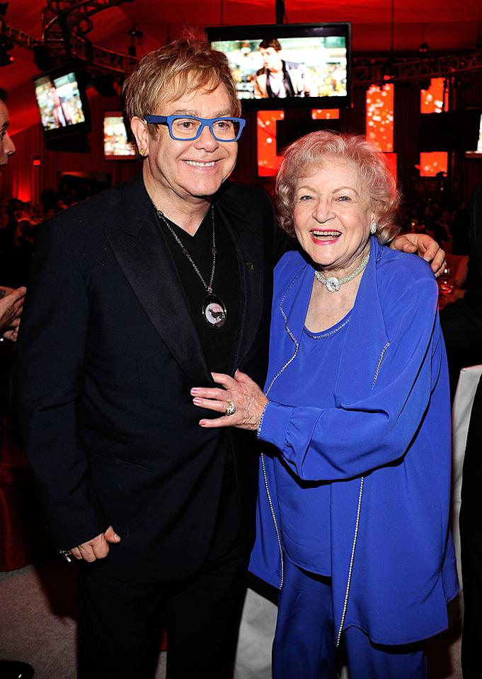 """Golden Girl Betty White, with a color-coordinated Elton John at his Oscars viewing party, was confirmed as host of """"Saturday Night Live"""" after a Facebook fan campaign was launched to land her the gig. The 88-year-old will host the show on May 8, and will be joined by former late night luminaries including Tina Fey and Amy Poehler. Larry Busacca/<a href=""""http://www.gettyimages.com/"""" target=""""new"""">GettyImages.com</a> - March 7, 2010"""