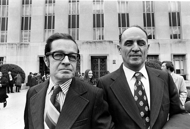 <p>James W. McCord Jr., right, former security chief for President Richard Nixon's re-election committee, and his attorney Bernard Fensterwald, leave U.S. District Court in Washington, D.C., Friday, Nov. 9, 1973. Judge Sirica imposed a sentence of one to five years on McCord for his role in the Watergate break-in. (Photo: AP) </p>