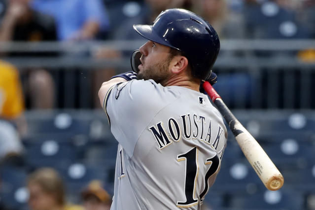 Milwaukee Brewers' Mike Moustakas watches his solo home run off Pittsburgh Pirates starting pitcher Joe Musgrove during the third inning of a baseball game in Pittsburgh, Thursday, May 30, 2019. It was his second home run of the game. (AP Photo/Gene J. Puskar)
