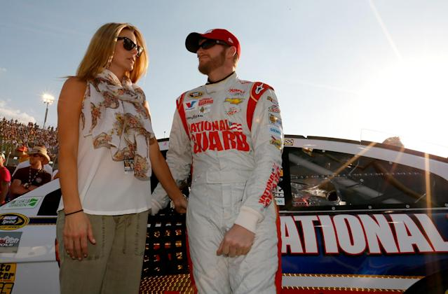 DARLINGTON, SC - APRIL 12: Dale Earnhardt Jr., driver of the #88 National Guard Chevrolet, stands on the grid with his girlfriend Amy Reimann before the start of the NASCAR Sprint Cup Series Bojangles' Southern 500 at Darlington Raceway on April 12, 2014 in Darlington, South Carolina. (Photo by Kevin C. Cox/Getty Images)