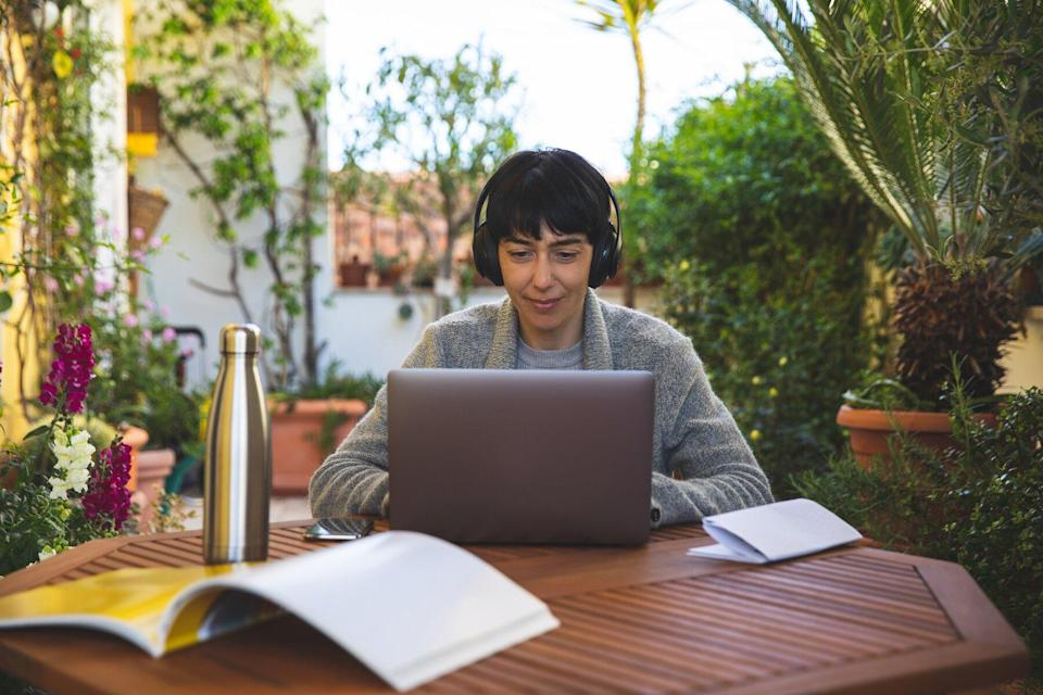 Woman at work from home patio