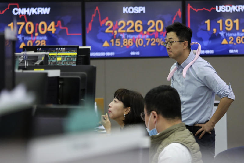 Currency traders watch monitors at the foreign exchange dealing room of the KEB Hana Bank headquarters in Seoul, South Korea, Thursday, Feb. 20, 2020. Asian shares were mixed Thursday after Wall Street recovered to record highs, but worries continued about the damage to the regional economy from the new virus that began in China. (AP Photo/Ahn Young-joon)
