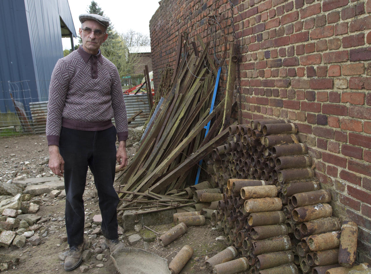 Farmer Didier Guerle shows World War One ammunition and other items that he has found in his fields in recent years near the site where he also located the bodies of two British World War One soldiers in Bullecourt, France on Monday April 22, 2013. Almost 100 years after they were killed in action, Lieutenant John Harold Pritchard and Private Christopher Douglas Elphick will be re-interred with full military honors in the H.A.C Cemetery at Ecoust-St. Mein, France, on Tuesday, April 23, 2013. (AP Photo/Virginia Mayo)