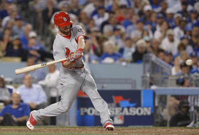 St. Louis Cardinals' Shane Robinson hits a home run during the seventh inning of Game 4 of the National League baseball championship series against the Los Angeles Dodgers, Tuesday, Oct. 15, 2013, in Los Angeles. (AP Photo/Mark J. Terrill)