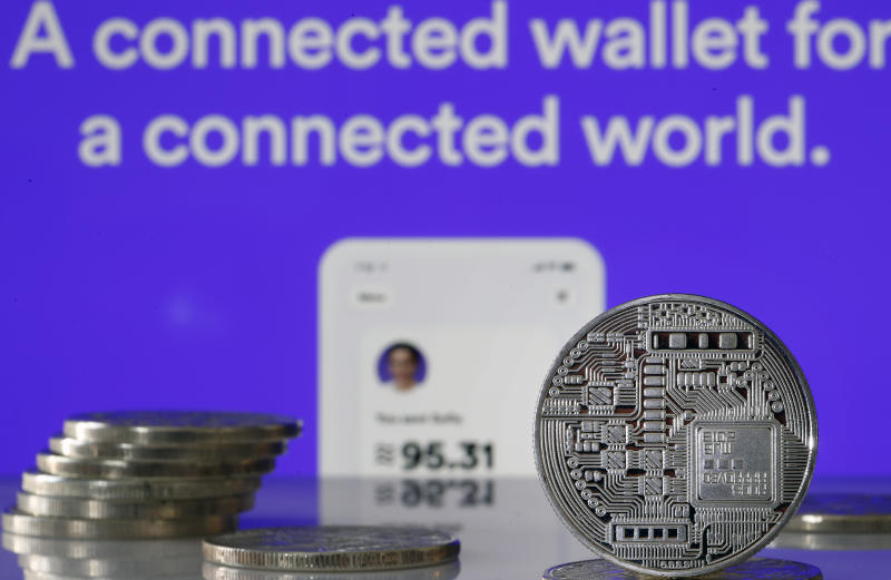PARIS, FRANCE - JULY 08: In this photo illustration, a visual representation of digital cryptocurrency coins sit on display in front the website home page Calibra on July 08, 2019 in Paris, France. Calibra is the digital wallet for Facebook's Libra cryptocurrency. Since the announcement of its creation a few days ago, the virtual currency of Facebook Libra fascinates as much as it worries. Libra, Facebook's cryptocurrency project, worries US representatives and senators: they ask the social network to pause its implementation, the time to investigate Libra and carry out impact studies. The Congress plans to release its findings on July 17, 2019. (Photo by Chesnot/Getty Images)