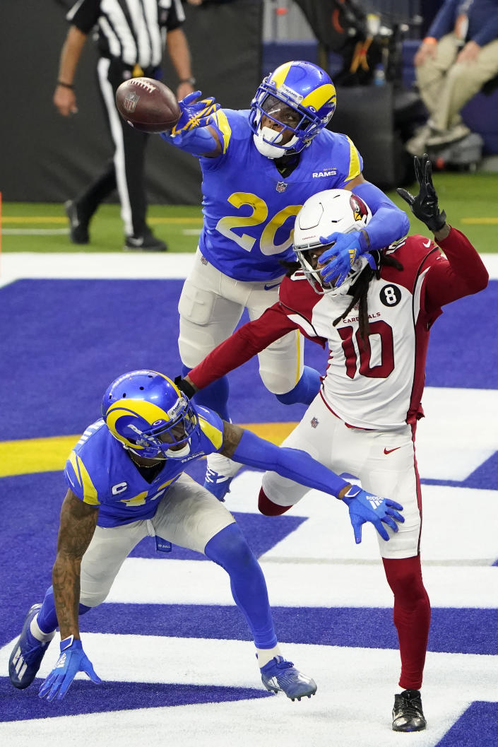 Los Angeles Rams cornerback Jalen Ramsey (20) and free safety John Johnson III, bottom, defend a pass intended for Arizona Cardinals wide receiver DeAndre Hopkins (10) during the second half of an NFL football game in Inglewood, Calif., Sunday, Jan. 3, 2021. (AP Photo/Jae C. Hong)
