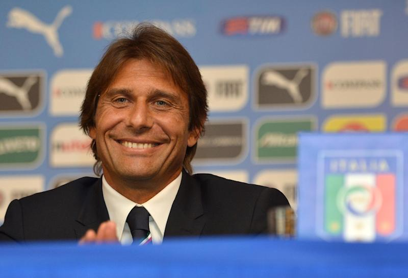 Italy's new coach Antonio Conte smiles during a press conference in Rome on August 19, 2014