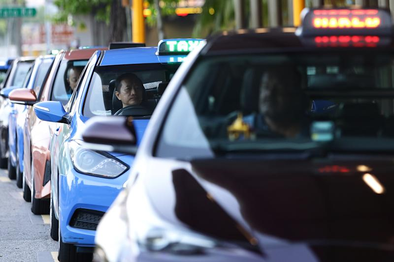 SINGAPORE - MARCH 28: Taxi drivers wait for customers at a taxi stand on March 28, 2020 in Singapore. Singapore government introduced a supplementary budget on March 26 with measures worth S$48 billion to support Singaporeans and businesses to cope with the Covid-19 pandemic. (Photo by Suhaimi Abdullah/Getty Images)