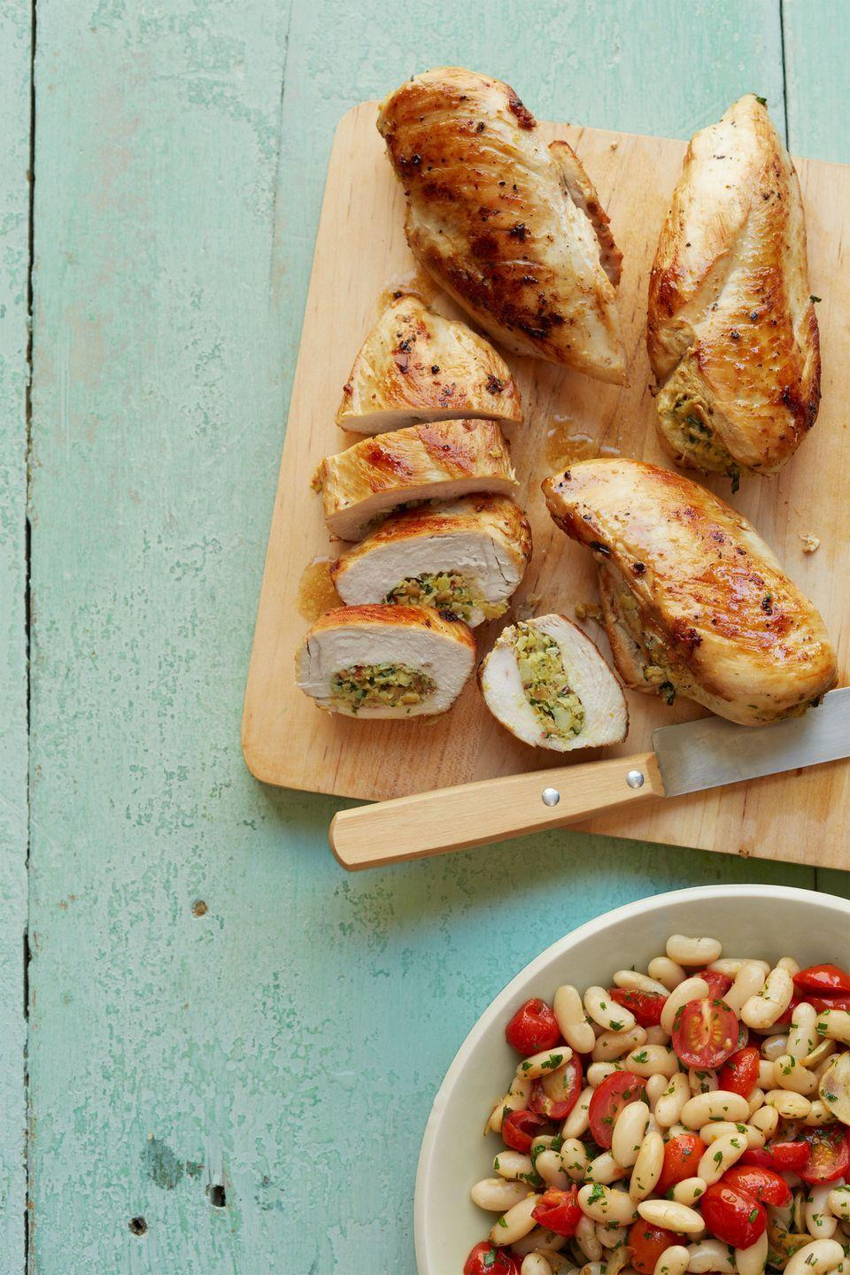 """<p>One of the best parts of this recipe is that the stuffing helps keep the breasts from drying out.</p><p><strong><a href=""""https://www.countryliving.com/food-drinks/recipes/a34231/artichoke-almond-stuffed-chicken-breasts-recipe-wdy0114/"""" rel=""""nofollow noopener"""" target=""""_blank"""" data-ylk=""""slk:Get the recipe"""" class=""""link rapid-noclick-resp"""">Get the recipe</a>.</strong></p><p><strong><a class=""""link rapid-noclick-resp"""" href=""""https://www.amazon.com/AVACRAFT-Stainless-Frying-Tri-Ply-Ergonomic/dp/B07F6DG3N1/r?tag=syn-yahoo-20&ascsubtag=%5Bartid%7C10050.g.32969162%5Bsrc%7Cyahoo-us"""" rel=""""nofollow noopener"""" target=""""_blank"""" data-ylk=""""slk:SHOP SKILLETS"""">SHOP SKILLETS</a><br></strong></p>"""