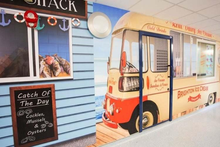 London's Royal Free Hospital has decorated its dementia wards, corridors and day rooms in a vintage seaside theme (PA)