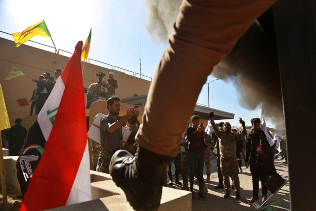 Protesters burn property as they gather in front of the U.S. Embassy in Baghdad on Dec. 31. (Photo: Khalid Mohammed/AP)