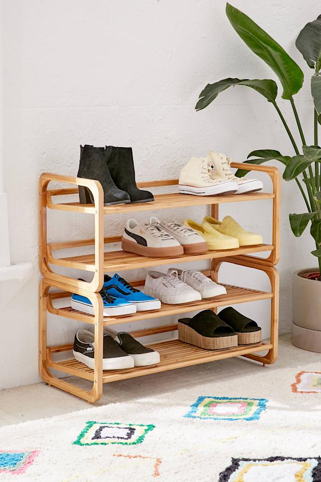 """<p>We love the look of this <a href=""""https://www.popsugar.com/buy/Stackable-Bamboo-Shoe-Rack-557988?p_name=Stackable%20Bamboo%20Shoe%20Rack&retailer=urbanoutfitters.com&pid=557988&price=89&evar1=casa%3Aus&evar9=46423680&evar98=https%3A%2F%2Fwww.popsugar.com%2Fhome%2Fphoto-gallery%2F46423680%2Fimage%2F47320841%2FStackable-Bamboo-Shoe-Rack&list1=shopping%2Corganization%2Csmall%20space%20living%2Chome%20organization&prop13=api&pdata=1"""" rel=""""nofollow"""" data-shoppable-link=""""1"""" target=""""_blank"""" class=""""ga-track"""" data-ga-category=""""Related"""" data-ga-label=""""https://www.urbanoutfitters.com/shop/stackable-bamboo-shoe-rack?category=SEARCHRESULTS&amp;color=020&amp;searchparams=q%3Dcloset&amp;type=REGULAR&amp;size=ONE%20SIZE&amp;quantity=1"""" data-ga-action=""""In-Line Links"""">Stackable Bamboo Shoe Rack</a> ($89).</p>"""