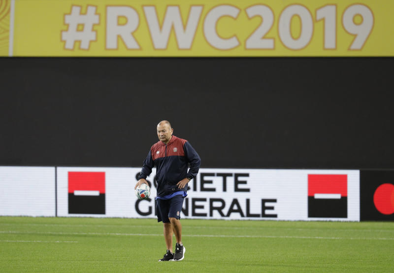 England rugby coach Eddie Jones watches his team during a training session before the start of Rugby World Cup in Sapporo, northern Japan Friday, Sept. 20, 2019. England will play Tonga on Sunday Sept. 22 in their first game. (AP Photo/Aaron Favila)