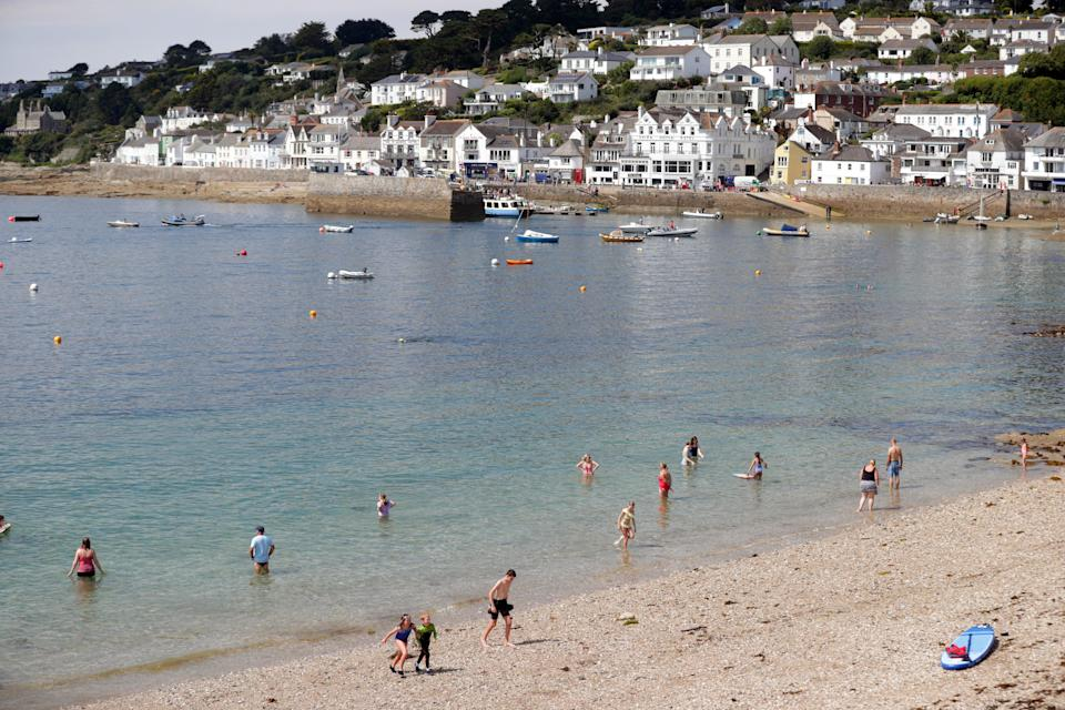 People on the beach at St Mawes, Cornwall (David Davies/PA) (PA Archive)