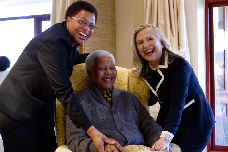 Secretary of State Hillary Rodham Clinton meets with former South Africa President Nelson Mandela, 94, and his wife Graca Machel at his home in Qunu, South Africa, Monday, Aug. 6, 2012. (AP Photo/Jacquelyn Martin, Pool)