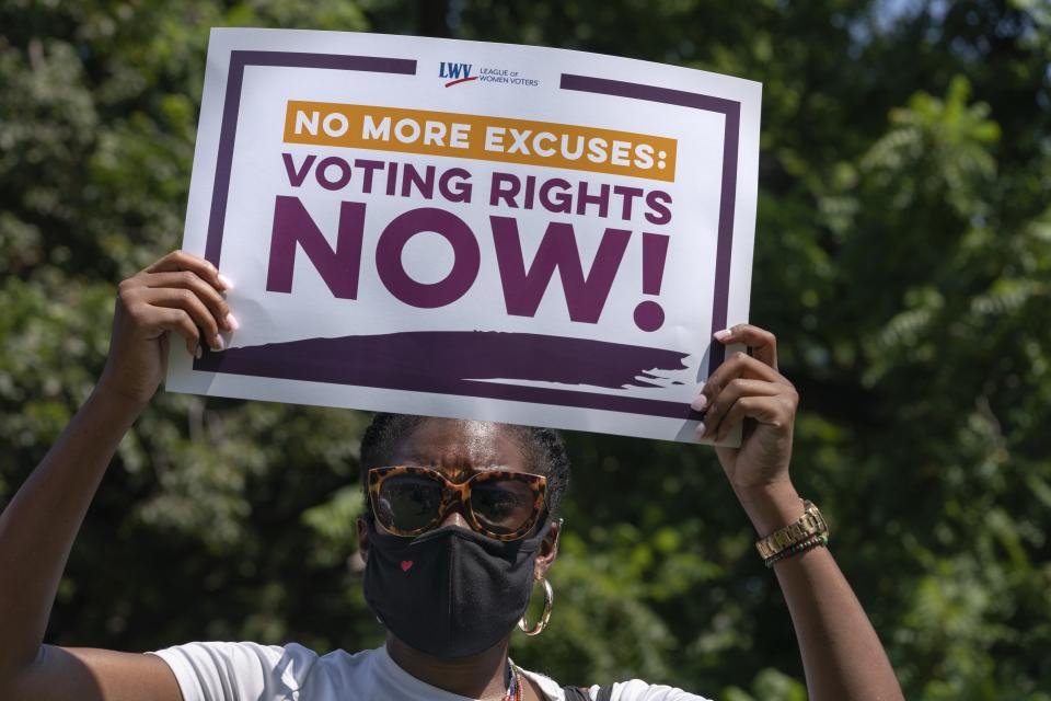 LaQuita Howard of Washington, with the League of Women Voters, attends a rally for voting rights, Tuesday, Aug. 24, 2021, near the White House in Washington. (AP Photo/Jacquelyn Martin)