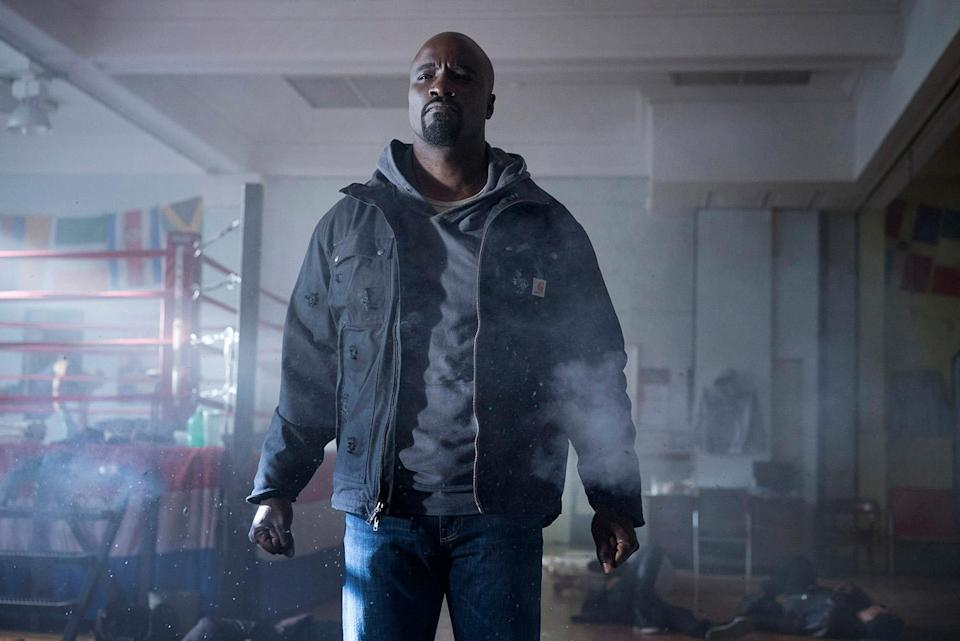 """<p>It's no secret the first 13 episodes of Netflix's <em>Luke Cage</em> are all named after Gang Starr songs. But is there a reason why the show is so deeply entrenched in classic hip-hop? <i>S</i>howrunner Cheo Hodari Coker told <a rel=""""nofollow noopener"""" href=""""https://hiphopdx.com/interviews/id.2969/title.marvel-luke-cage-gang-starr-cheo-hodari-coker"""" target=""""_blank"""" data-ylk=""""slk:HipHopDX"""" class=""""link rapid-noclick-resp"""">HipHopDX</a> he took a page from Shondaland's book, as well as a trick he used in music journalism class, where he learned to pick a song for a cover line. """"It was really just a combination of finding songs titles that resonate and then seeing how you can build cinematic resonance with your story and your characters,"""" Coker explained. """"What I noticed in going through my iTunes is that Gang Starr songs always had that kind of presence, and so it just worked basically picking those song titles and making it into something.""""<br><br>(Photos: Myles Aronowitz/Netflix) </p>"""