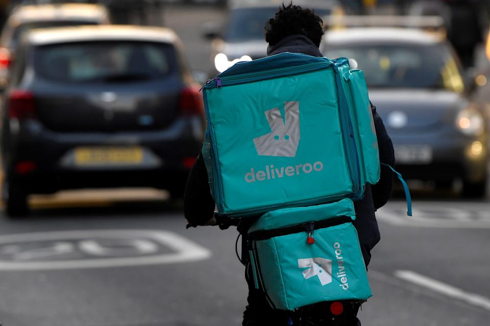 A Deliveroo delivery rider cycles in London, Britain, March 8, 2021. REUTERS/Toby Melville
