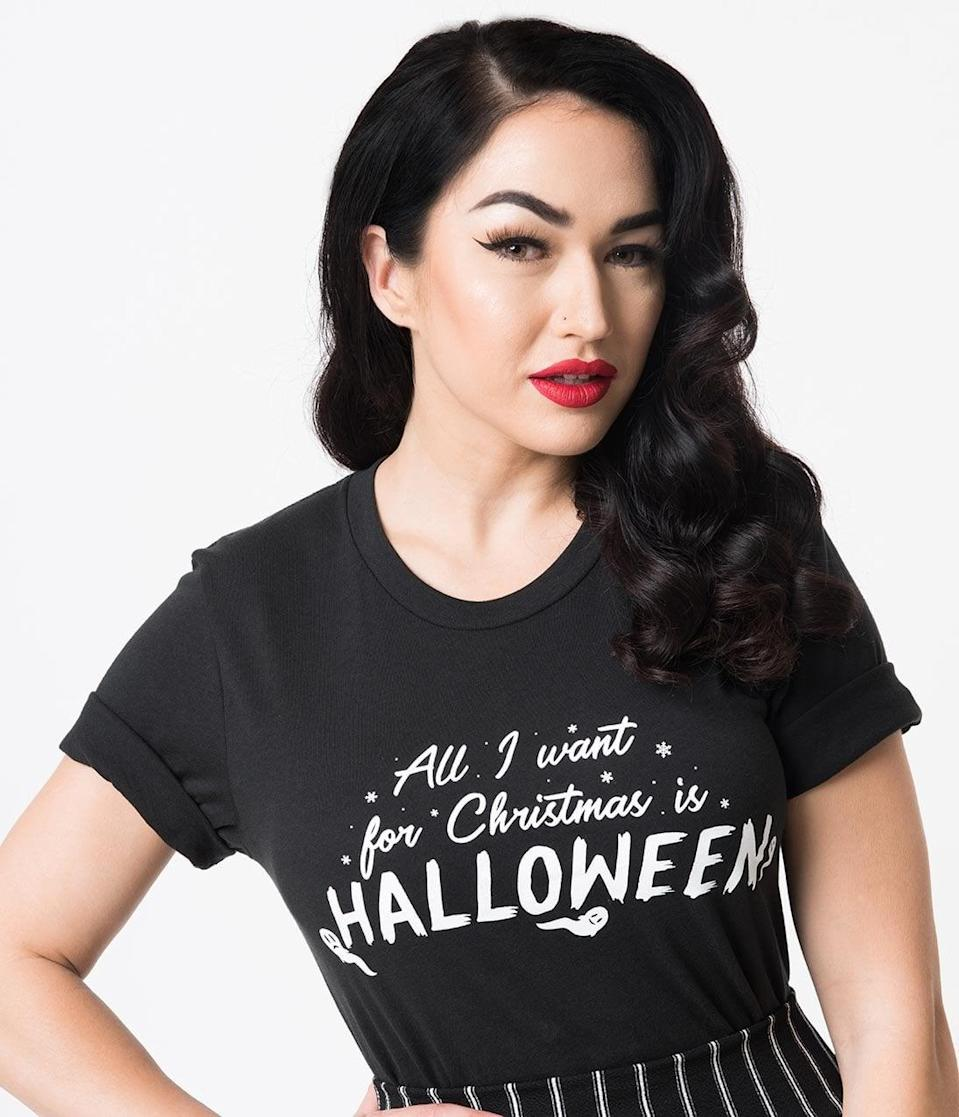 <p>There's no shame in wearing the <span>Unique Vintage Black All I Want For Christmas Is Halloween Unisex Tee</span> ($28) year-round. </p>