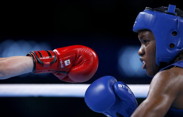 England's Nicola Adams during a boxing match at the 2014 Commonwealth Games in Glasgow, Scotland, on August 2, 2014 (AFP Photo/Adrian Dennis)