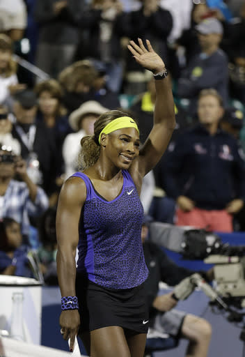 Serena Williams waves after beating Ana Ivanovic, from Serbia, during match in the Bank of the West Classic tennis tournament in Stanford, Calif., Friday, Aug. 1, 2014. Williams won 2-6, 6-3, 7-5. (AP Photo/Jeff Chiu)